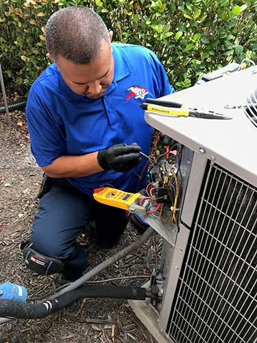 AC technician performing maintenance